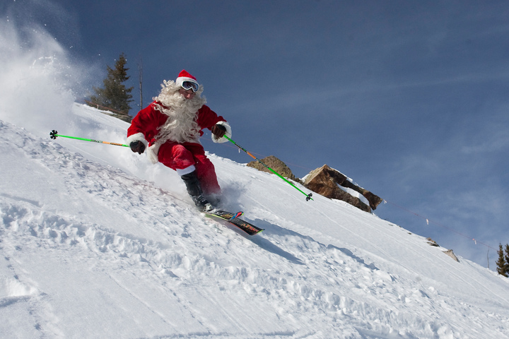10 Ways to Spend Your Holiday in Aspen - Santa skiing at The Little Nell